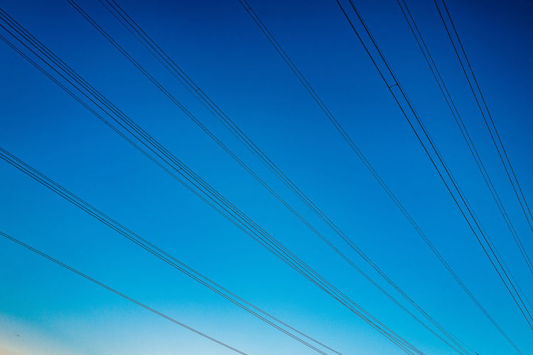 Blue Cable Clear Sky Connection Copy Space Day Electricity  Electricity Pylon Fuel And Power Generation Gormund Kapelle Low Angle View Nature No People Outdoors Power Cable Power Line  Power Supply Silhouette Sky Technology Tranquility