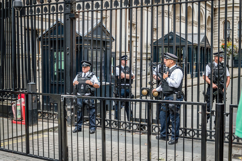 Policemen guarding the entrance to 10th Downing Street Barrier Brexit City England Guards Guns London London Life London Lifestyle Police Pollen Prime Minister Protection Safety Security Street Terrorism Urban