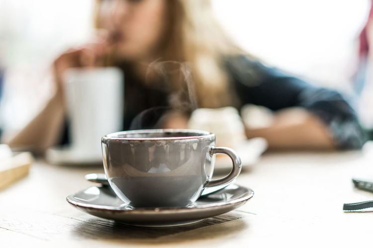 Mid Section Of Woman Sitting At Cafe
