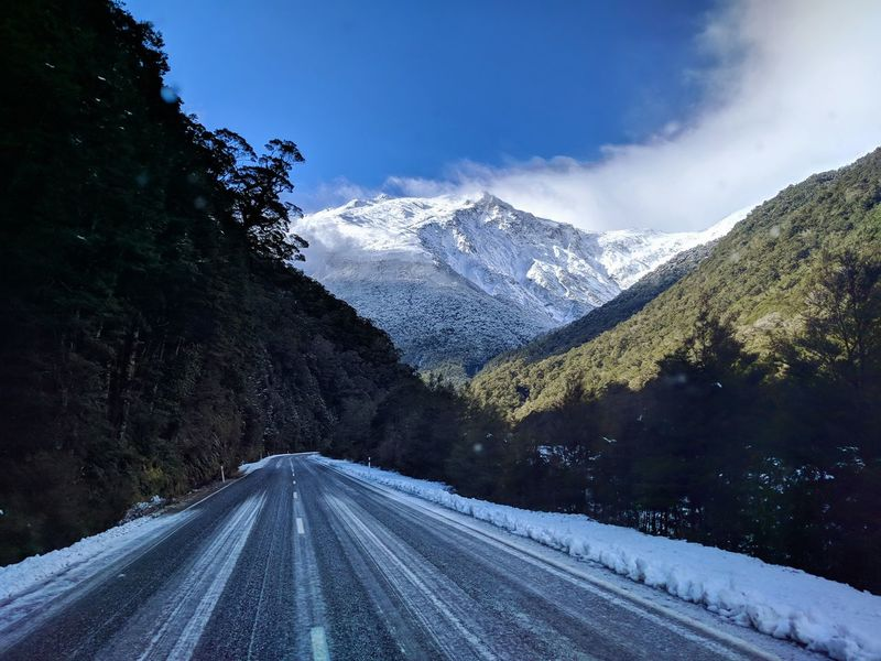Beauty In Nature Cold Temperature Crash Barrier Diminishing Perspective Direction Mountain Mountain Range Nature New Zealand No People Outdoors Plant Road Scenics - Nature Sky Snow Snowcapped Mountain The Way Forward Tranquil Scene Tranquility Transportation Tree Winter