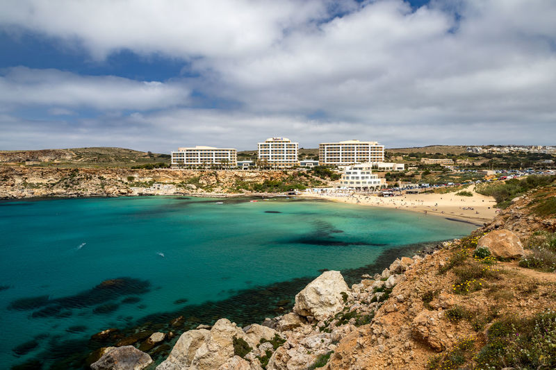 Golden Bay, Riviera Beach and Popeye's Village on Malta Zurrieq Malta Maltaphotography Watchtower Riviera Beach Ghajn Tuffieha Tuffieha Golden Bay Popeye Popeyevillage Blue Water Turquoise Colored Turquoise Water Solar Halo Beachside Anchor Bay Nature Outdoors