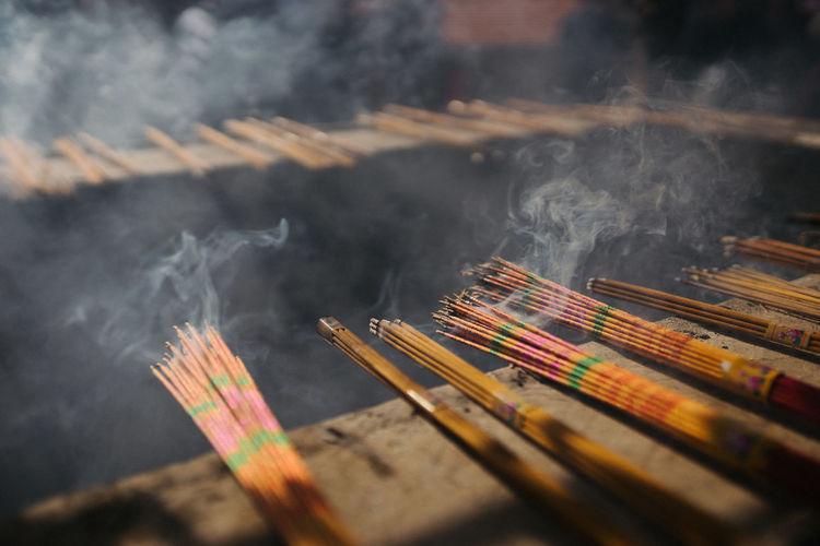 Close-up of smoke emitting from burning incense