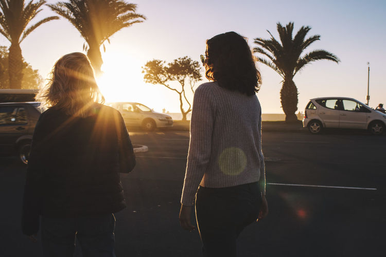City Day Friendship Girls Lifestyles Outdoors Palm Tree Sunset Tree Two People Walking