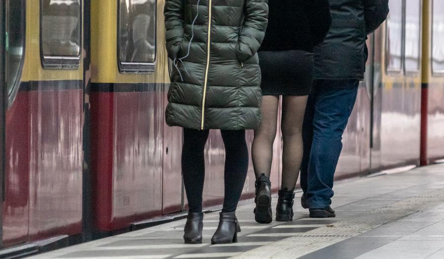 Low section of people walking on railway bridge