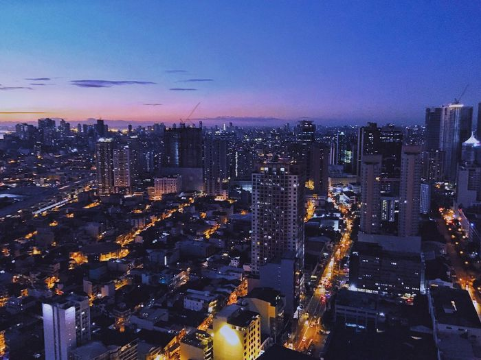 I'm a sunrise person but there's no way I wouldn't love sunsets. Makati City, Philippines Building Exterior Illuminated Sky Cityscape Built Structure Modern High Angle View City Life Building Night