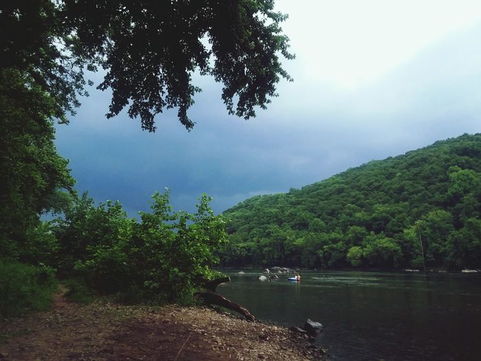 Stormy weather. #outdoors Skyline Water Artlovelaughter Tree Water Mountain Forest Lake Tree Area Lush - Description Reflection Outdoor Pursuit Pine Woodland