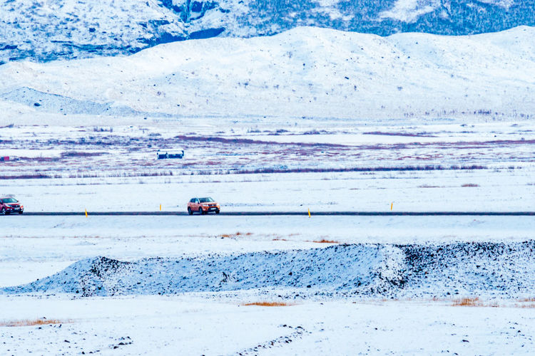 Two Cars In Snow Covered Landscape
