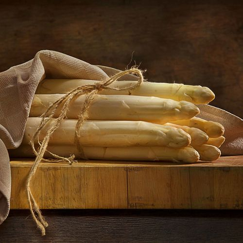 Close-up of white asparagus on table