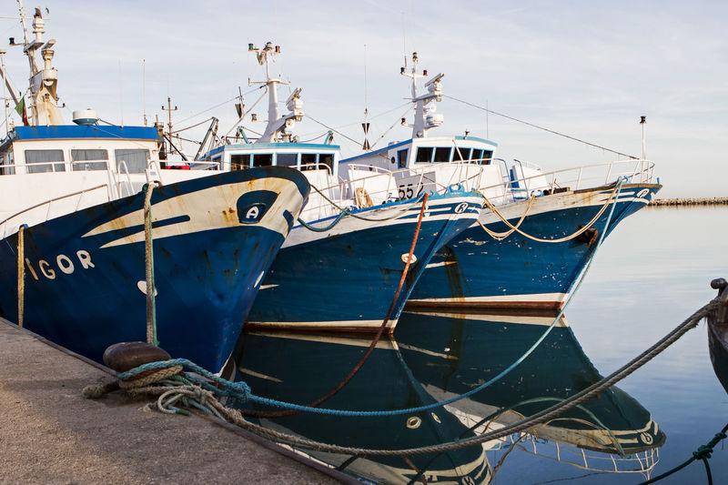 Trawlers moored on sea
