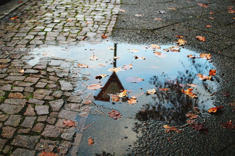 High angle view of puddle on wet street