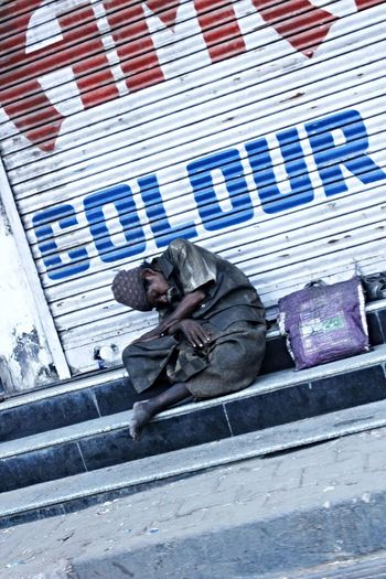 Adult Adults Only Building Exterior Colour ColourOFlife Day Full Length Indiacolours Men One Man Only One Person Only Men Outdoors People Poorpeople Poverty Povertyofindia Sleeping Social Issues Staircase Steps Tilt