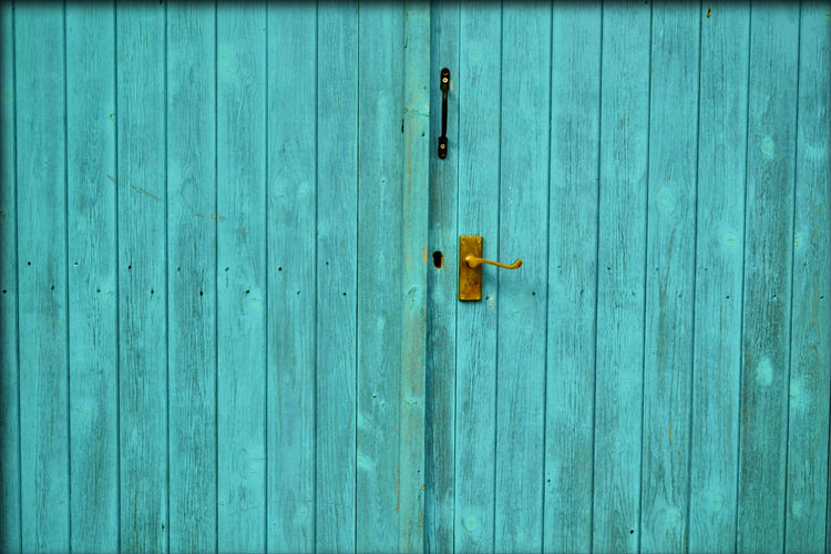 Backgrounds Blue Close-up Closed Colors Contrasting Colors Contrasting Textures Crafts Craftsmanship  Day Decoration Door Door Knob Doors DoorsAndWindowsProject EyeEmNewHere No People Outdoors Textured  Textures And Surfaces Vivid Colours  Wood - Material