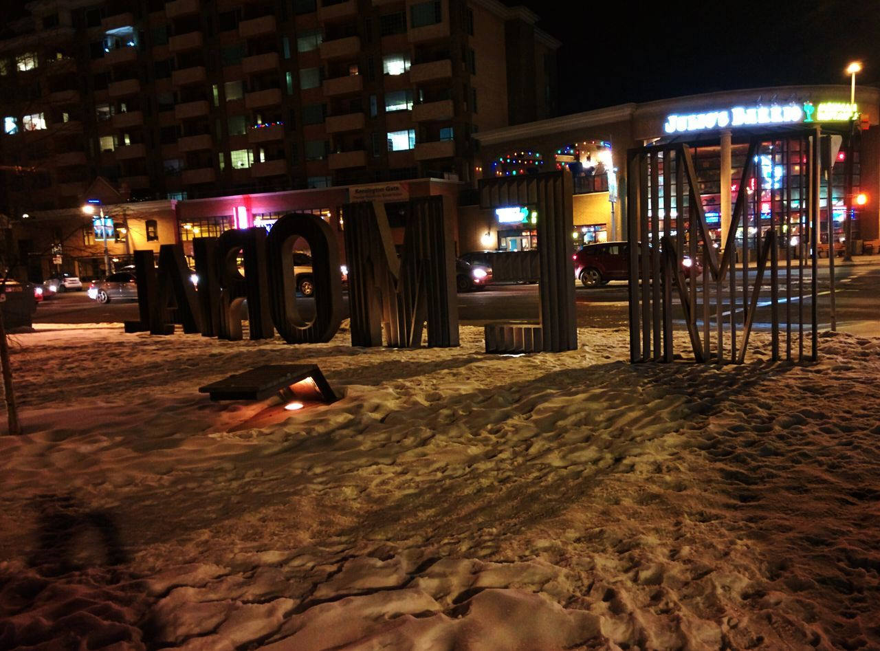 night, illuminated, architecture, built structure, building exterior, real people, sand, outdoors, sky, city