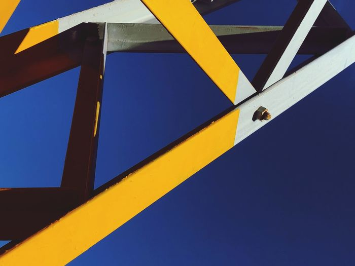 No People Architecture Yellow Blue Built Structure Low Angle View Sign Day