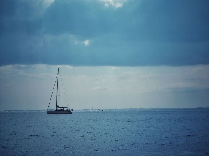 Blue Blue Nautical Vessel Sea Water Transportation Sky Cloud - Sky Mode Of Transportation Sailboat Horizon Over Water Sailing Scenics - Nature Horizon Travel Beauty In Nature Tranquility Tranquil Scene Nature Day Ship No People
