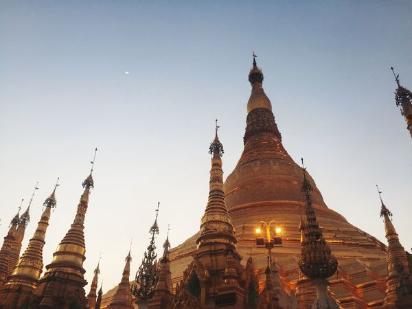 The spectacular Shwedagon Pagoda during sunset time in Yangon , Myanmar . Rangoon Pagoda Myanmar Pagoda Myanmarphotos Eyeem Myanmar Architecture Travel Destinations IPhoneography 43 Golden Moments Feel The Journey Original Experiences Showcase June