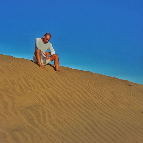 Maspalomas Desert One Person One Man Only Only Men Sand Adults Only Adult People Men Outdoors Blue Desert Sitting Sand Dune Technology Sky Lifestyles Day Wireless Technology Full Length Nature Freedom Desert Wüste  Maspalomas Sandstone