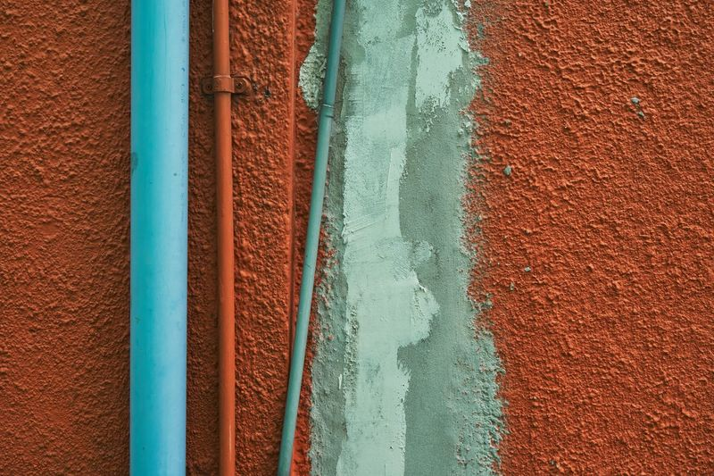 colorful wall detail Colors Textured  Abstract Architecture Backgrounds Blue Blue And Orange Blue Pipe Brown Building Exterior Built Structure Close-up Day Full Frame No People Orange Color Outdoors Painted Walls Pattern Pipe - Tube Red Surface Textures Textured  Wall Wall - Building Feature Wall Detail Water