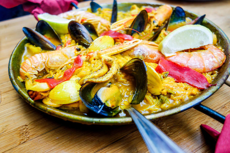 Close-Up Of Paella Served On Table