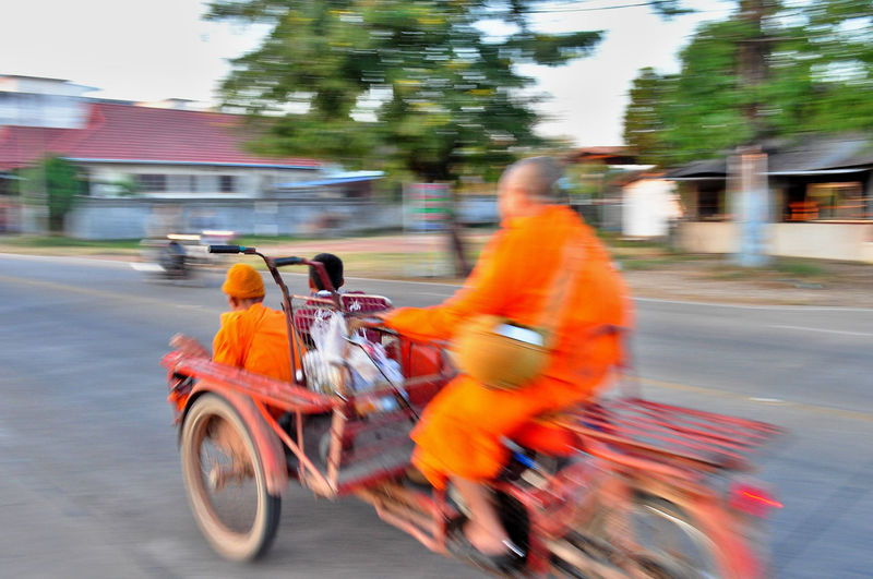 Monks on tricycle Amazing Thailand Blurred Motion Buddhist Monks Cheap Transport City Getting Around Land Vehicle Mode Of Transport Monks In Motion Motion Road Saffron Robes Street Transportation Travelling Monks Tricycle Driver