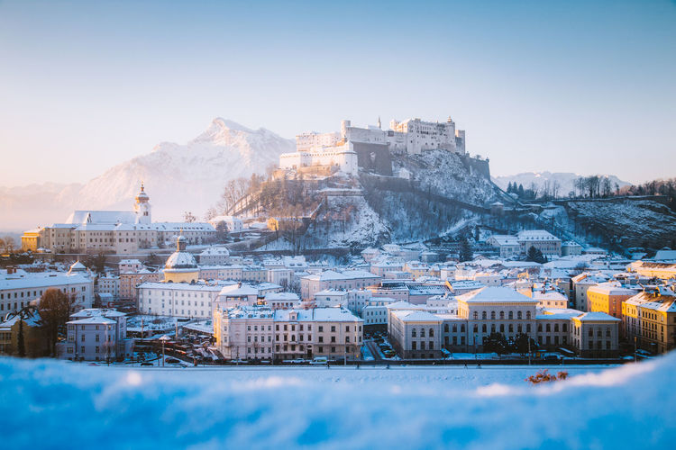 Snowcapped townscape against clear sky