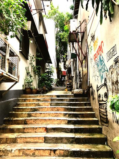 Alleyway steps in Hong Kong Urban Architecture Built Structure Building Exterior The Way Forward Staircase Direction Building Day No People Sunlight Steps And Staircases Outdoors City Graffiti Footpath #urbanana: The Urban Playground