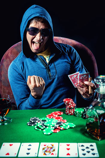 Poker player. Gambling concept Blackjack Casino Gambling Jackpot Man Objects Poker Addiction Bet Casino Night Chance Entertainment Fortune Gambler Gambling Chip Game Male One Person Player Playing Card Games Poker - Card Game Poker Chips Poker Game Studio Shot Young Adult