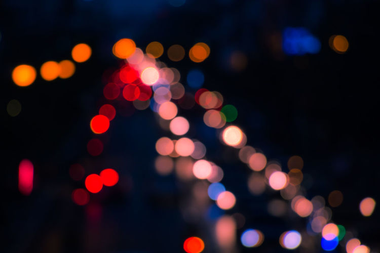 Celebration Christmas Decoration Christmas Lights City Close-up Defocused Fairy Lights Focus On Foreground Glowing Illuminated Light Effect Lighting Equipment Multi Colored Night No People Outdoors