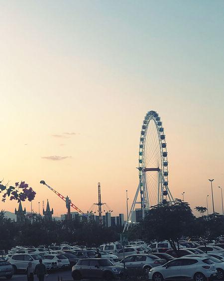 Ferris wheel against sky at sunset