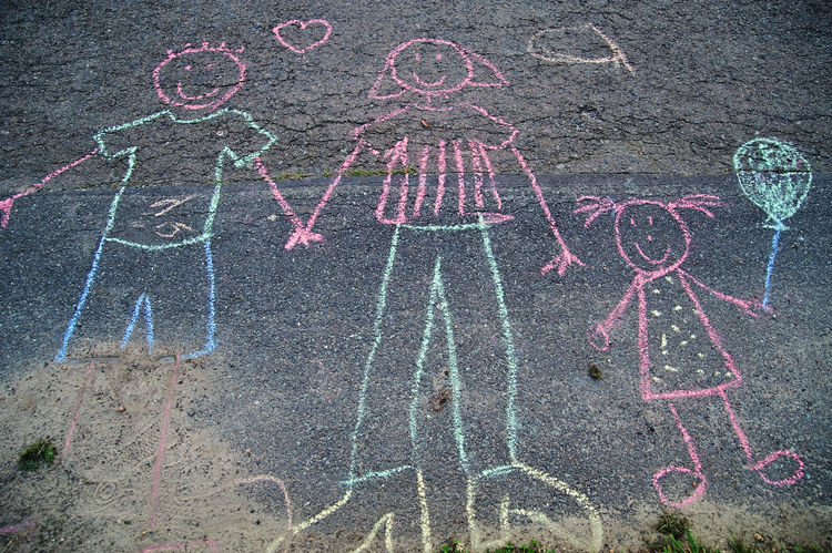 a childs chalk drawing on street Chalk Chalk Drawing Child Child Drawing Childhood Day Drawing Happiness Multi Colored Outdoors Parents And Children People Pink Color Street