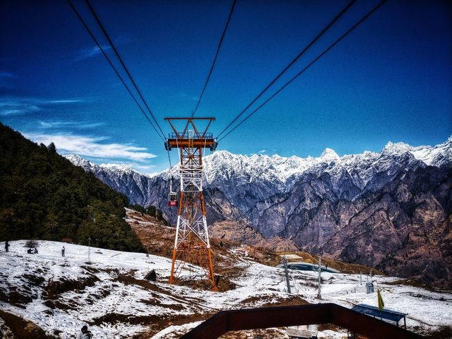 Auli Ropeway, 2nd Largest In world Thrill 1110 Metres Ascent 4.5 Kms Distance Snow Covered Hills Mountain Range Blue Skies And White Clouds Landscape Hill Station Chilly Weather Day Snow Clear Sky Outdoors High Altitude Rocky Mountains Daytime Mountain Peak Hill Stations Skiing Resort Ropeway Stn. At Hill Top Snow Capped Mountains Arid Landscape Snowcapped Skiing Ski Track Go Higher Summer Exploratorium The Great Outdoors - 2018 EyeEm Awards