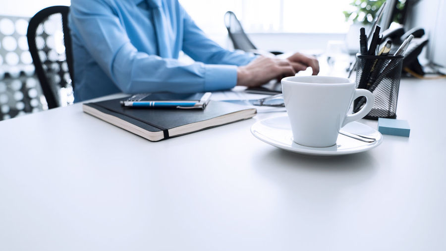 Office Business Business Person Businessman Coffee Cup Communication Connection Indoors  Technology Using Laptop Wireless Technology Working