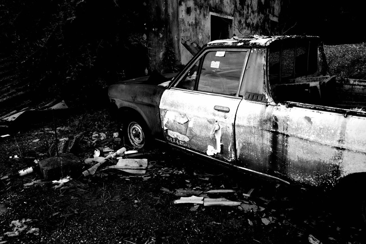 VIEW OF ABANDONED CAR ON LAND