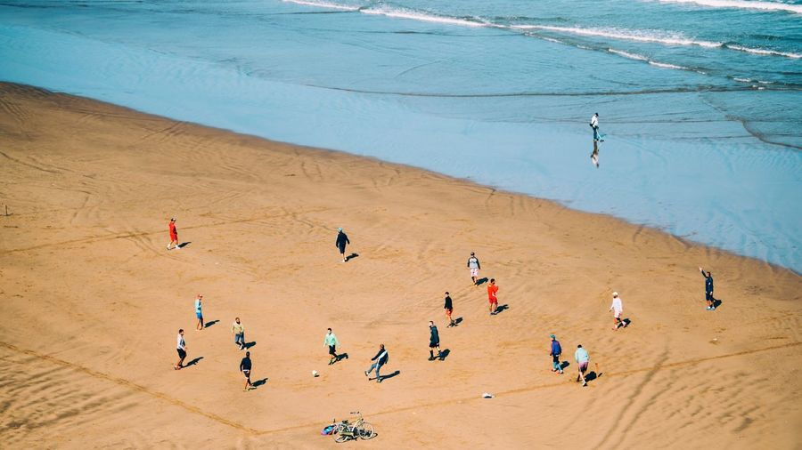 High angle view of people playing soccer at beach