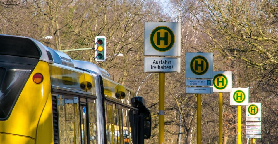 In A Row Yellow Public Transport Public Transportation Bus Stop Stop Bus Zehlendorf Mode Of Transportation Yellow Communication Sign Text Tree Transportation Land Vehicle No People Car Number Western Script Motor Vehicle Focus On Foreground Travel Bare Tree Outdoors #FREIHEITBERLIN