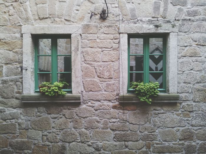 Two Windows In Stone Wall