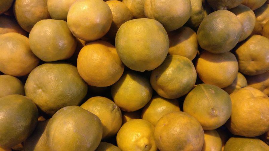 Full frame shot of orange fruits for sale in market