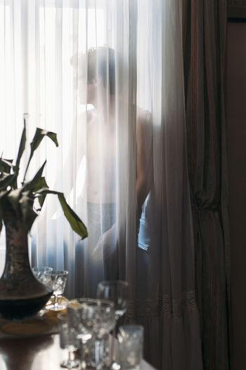 Man seen through window at home