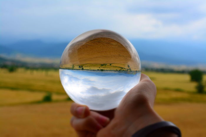 Crystal ball Sphere Outdoors Crystal Ball Nature Day Close-up Sky Fragility Cloud - Sky Human Body Part Human Hand Holding One Person People Adult Human Eye Beach Eyesight Adults Only Solar Eclipse