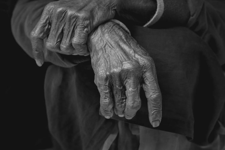 Detail of an elderly woman's wrinkled hands. Yogyakarta, Indonesia. Hand Human Hand Human Body Part Body Part Finger Real People Wrinkled Close-up Senior Adult Adult Detail Human Finger Holding Elderly Woman Old Fingers Aged Lifestyles Female Isolated