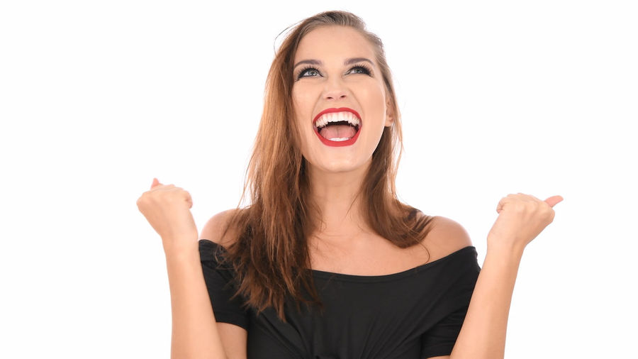 White Background Studio Shot Young Adult Young Women Cut Out One Person Indoors  Women Front View Portrait Emotion Hair Casual Clothing Mouth Open Mouth Looking At Camera Beauty Hairstyle Beautiful Woman Making A Face