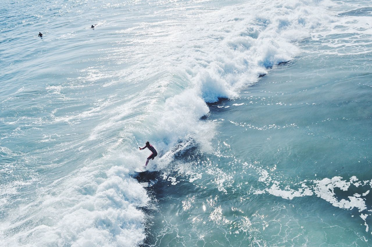 High angle view of man surfing on wave in sea