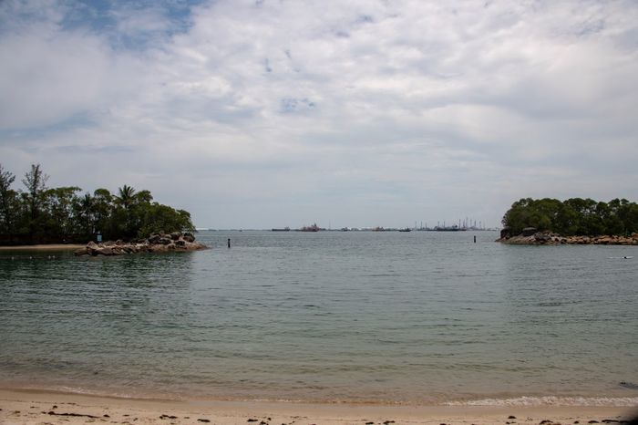 Singapure Beach View Sentosa Island Water Sky Cloud - Sky Beach Land Tree Beauty In Nature Nature Scenics - Nature Plant Sea Day Tranquility Tranquil Scene Sand No People Outdoors Idyllic Nautical Vessel