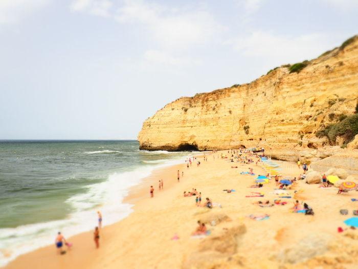 Algarve Praia Dos Carvalhos EyeEm Selects Sea Beach Wave Sand Water Rock - Object Sky Horizon Over Water Travel Seascape Coast Rock Formation Cliff Coastline Eroded
