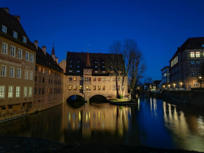 Reflection Illuminated Water Dusk City Building Exterior Travel Destinations Architecture Bridge - Man Made Structure Night Built Structure Vacations No People Outdoors Cityscape Sky Nürnberg River Nightlife