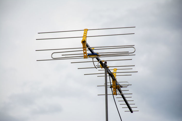 Low angle view of antenna against sky