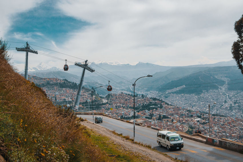Going up to El Alto. A city that lies 4,150m over sea level. La Paz and El Alto are connected by a cable car made by an Austrian company. The city is also accessible by a steep and dangerous road. A car wreck that hangs inbetween the cliffs should be enough of a sign. Cable Car El Alto Latin America Public Transportation Ski Lift Transportation Beauty In Nature Bus Cable Car City Day Environment Landscape Mode Of Transportation Motor Vehicle Mountain Mountain Range Nature No People Outdoors Road Snowcapped Mountain South America Travel Destinations The Traveler - 2018 EyeEm Awards