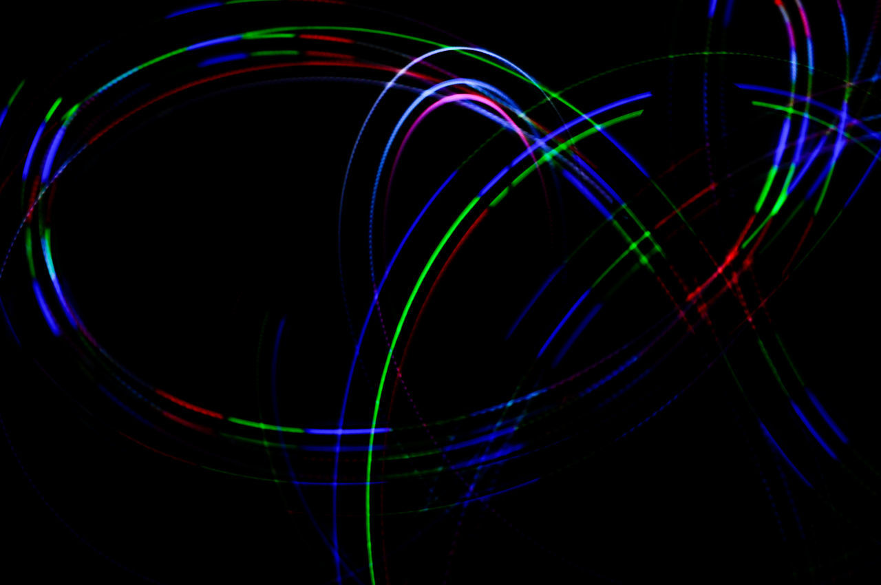 illuminated, night, light trail, multi colored, no people, close-up, studio shot, black background, fiber optic, neon, outdoors