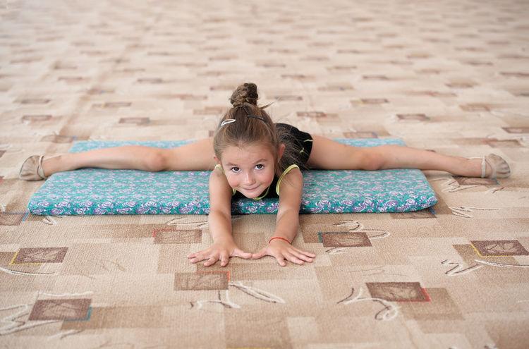 Athlete Caucasian Child Childhood Exercise Female Flexible Girl Gym Gymnast  Gymnastics Horizontal Indoors  Kid Leg-split Practice Sport Sportive Sportsman Stretch Workout