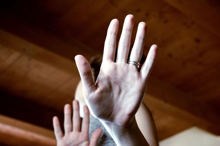 Low Angle View Of Woman Hand Showing Stop Gesture At Home